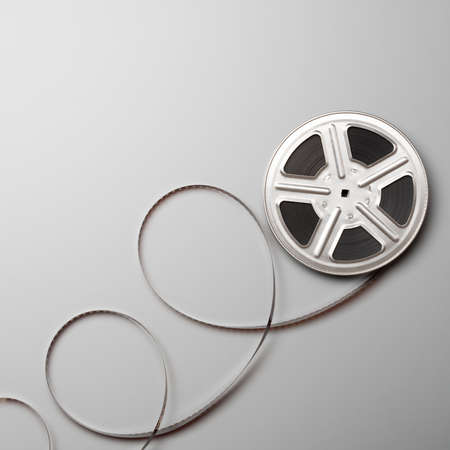 16mm: Motion picture film reel.