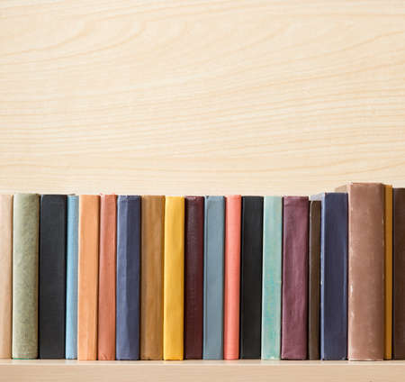 book spine: Old books on the shelf.