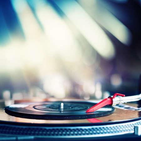 dj music: Vinyl record spinning on DJ turntable