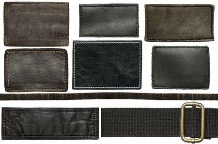 Black leather jeans labels and straps Reklamní fotografie - 27153182