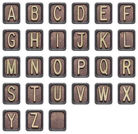 Metal button alphabet letters isolated on white photo