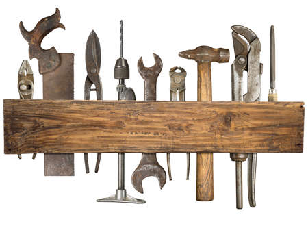 Old rusty tools under wooden plank. photo