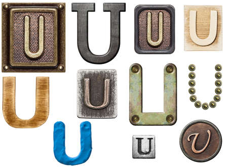 Alphabet made of wood, metal, plasticine. Letter U photo