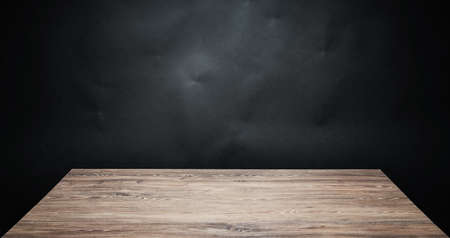 black appliances: Wooden table top against dark background