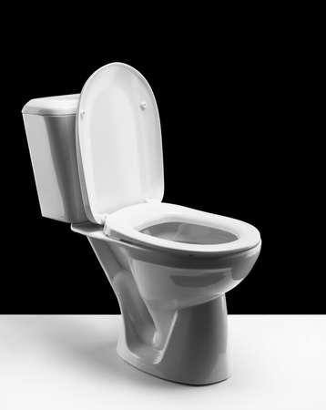 Toilet bowl on black background