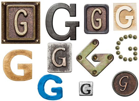 g: Alphabet made of wood, metal, plasticine. Letter G Stock Photo