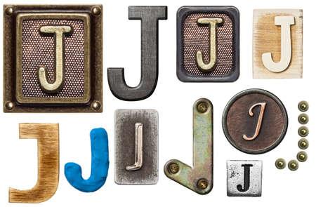 Alphabet made of wood, metal, plasticine. Letter J photo