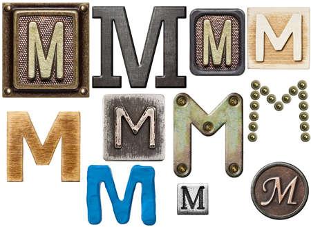 wooden block letter: Alphabet made of wood, metal, plasticine. Letter M