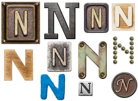 wooden block letter: Alphabet made of wood, metal, plasticine. Letter N
