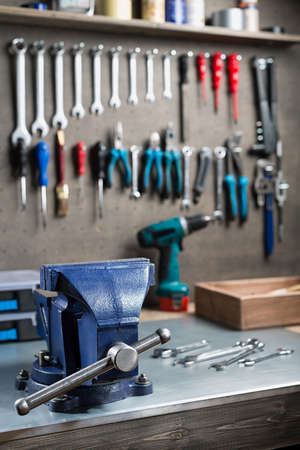 carpenter vise: Workshop scene.  Tools on the table and wall. Stock Photo