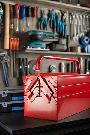 Workshop scene.  Toolbox on the table. photo