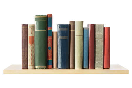 stack of books: Books on the shelf, isolated. Stock Photo
