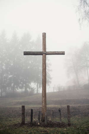 fog: Christian cross in the fog Stock Photo
