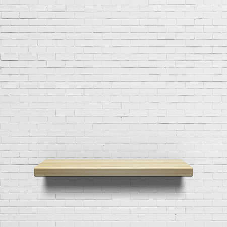 shelf: Wooden shelf on a white brick wall