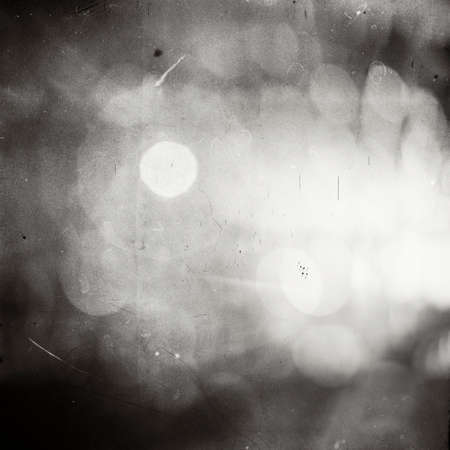 grains: Abstract sunlight on film. Lots of grain, scratches and dust. Stock Photo