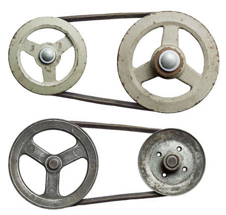 Old metal pulleys with belt. photo