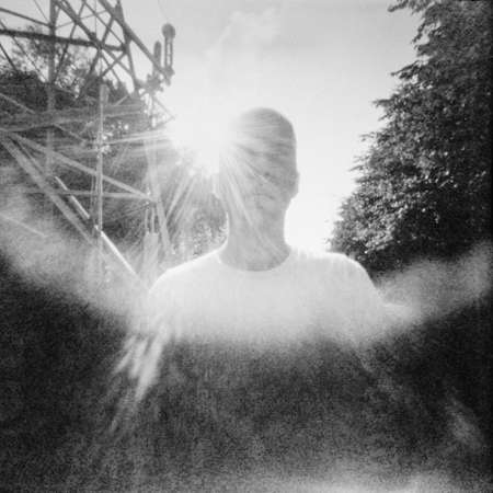 Sunny summertime portrait in lomography style.  Used pinhole film camera. Image contains grain and blur. photo