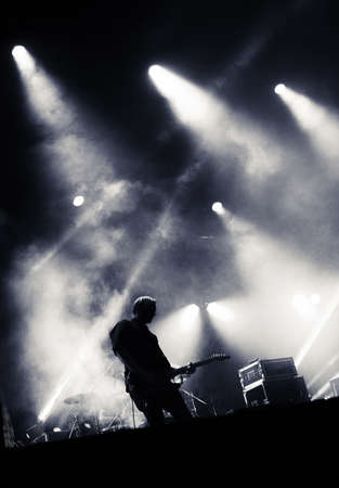 Rock concert stage. Guitarist playing on electric guitar. Archivio Fotografico