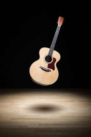 Acoustic guitar floating in the air photo