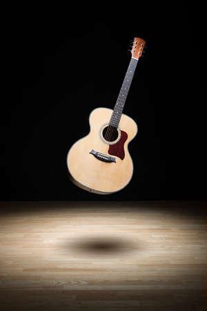 air guitar: Acoustic guitar floating in the air
