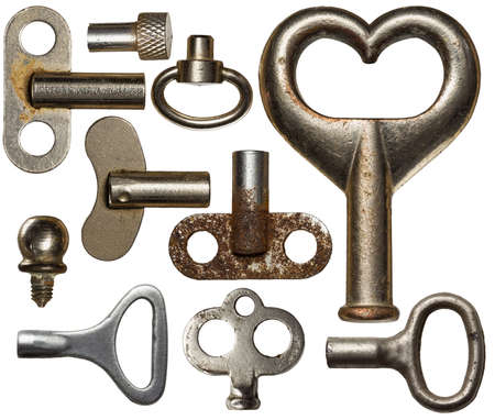 passkey: Collection of old clockwork keys, isolated. Stock Photo