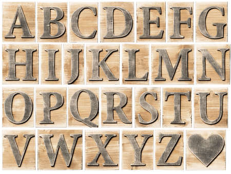 letterpress type: Wooden alphabet letter blocks isolated on white