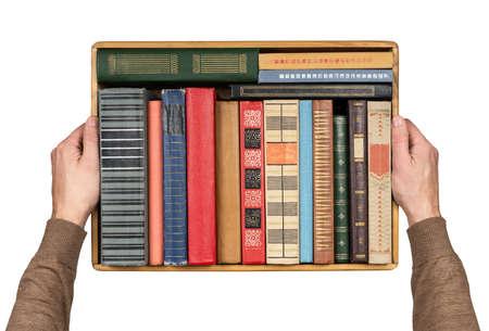 book spine: Hands holding box full of books