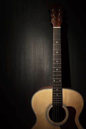 Acoustic guitar in the dark Stock Photo