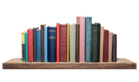 Books on the shelf, isolated. Stock Photo
