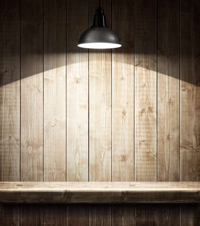 Empty wooden shelf under the lamp