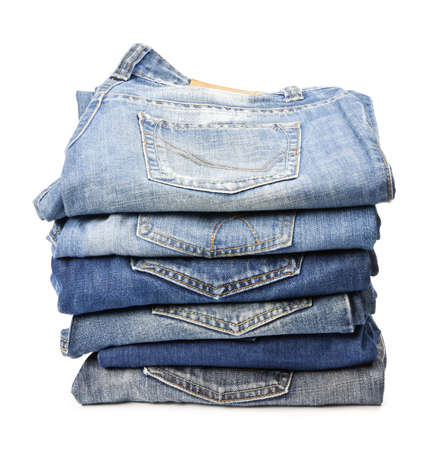 jeans texture: Jeans trousers stack on white background
