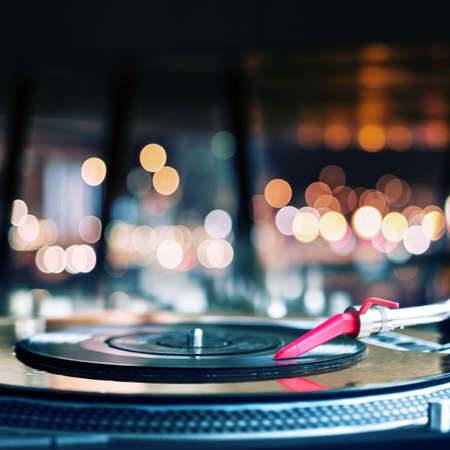 electronic music: Vinyl record spinning on DJ turntable