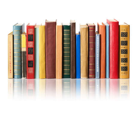 columna vertebral: Libros sobre fondo blanco con la reflexi�n Foto de archivo
