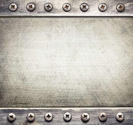 Industrial metal background with screws.
