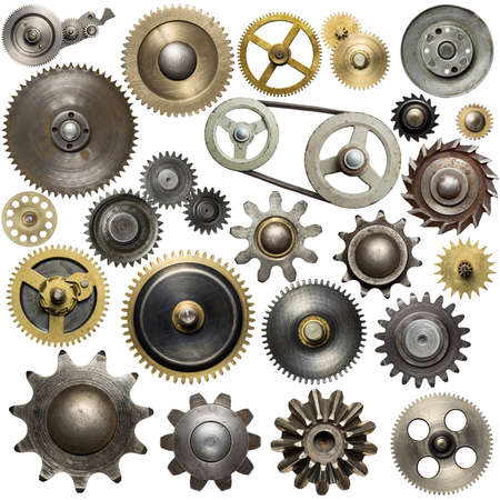drives: Metal gear, cogwheels, pulleys and clockwork spare parts. Stock Photo