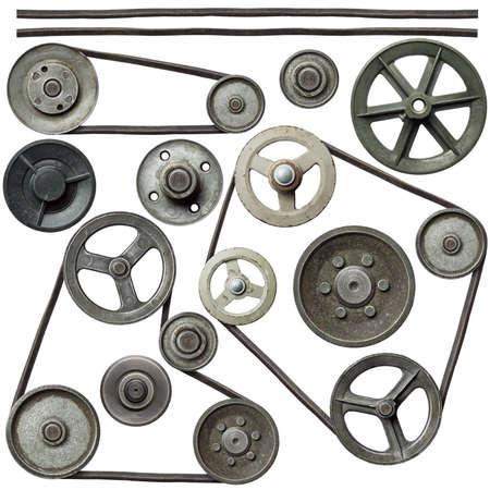 pulleys: Poleas viejas del metal con la correa.
