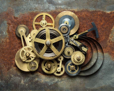 maquina de vapor: Metal collage de un reloj en el fondo oxidado Foto de archivo