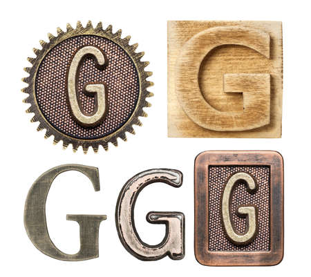 write letter: Alphabet made of wood and metal. Letter G