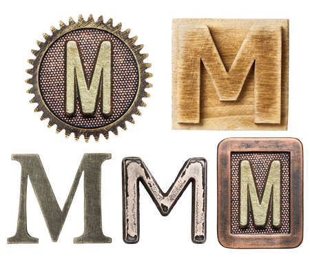 write letter: Alphabet made of wood and metal. Letter M