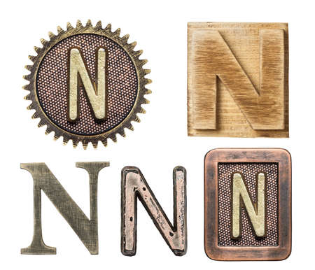 writing a letter: Alphabet made of wood and metal. Letter N