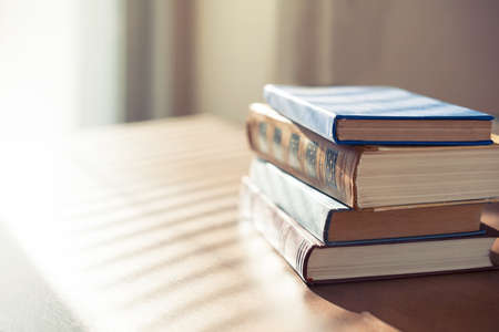 Books on the table in front of sunlight. Shallow depth of field. Stock Photo - 40564526