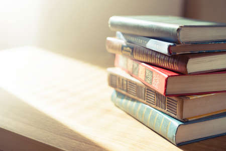 bookshelf: Old books on wooden table.Shallow depth of field.