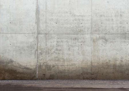 Fond urbain. Mur de béton vide et le plancher.