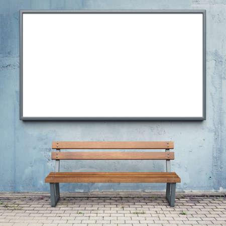 Blank advertising billboard on a street wall. Foto de archivo