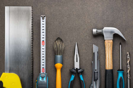 Various carpentry, construction tools on the board. Stock Photo - 42104088