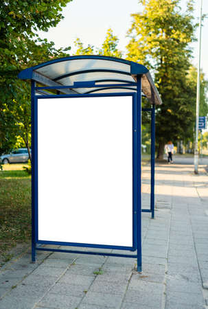 Blank bus stop advertising billboard in the city.