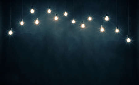 Light bulbs on dark blue background Imagens