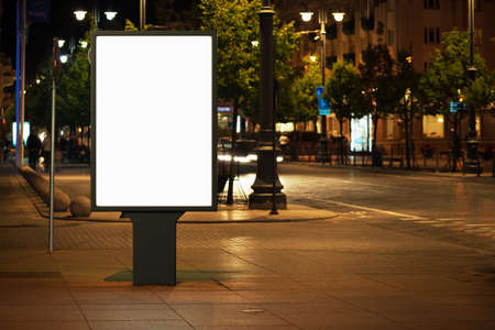 outdoor: Blank advertising billboard in the city at night.