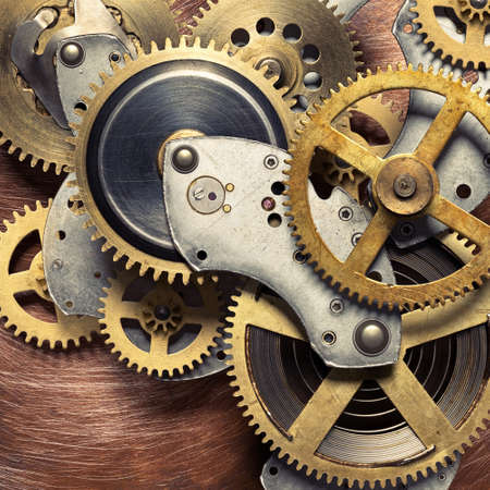 copper background: Metal collage of clockwork gears on copper background Stock Photo