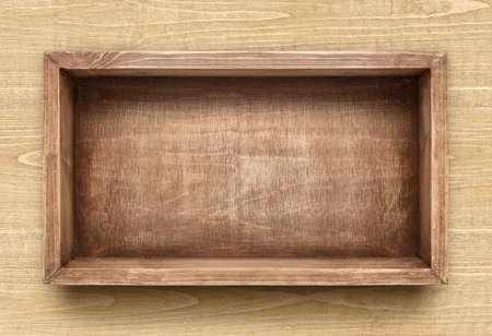 Empty rustic wooden box on the table Standard-Bild